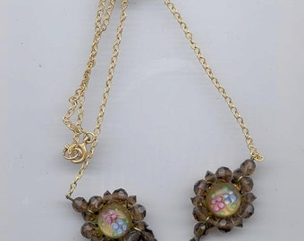 Beautiful and delicate vintage necklace with three small pendant beads