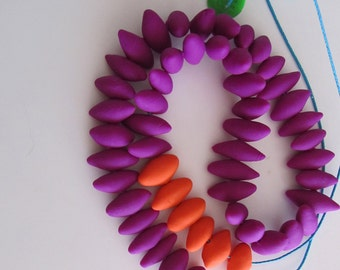 purple and orange seed pod oval football shape polymer necklace