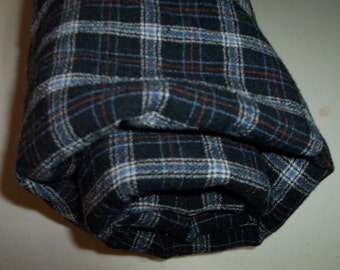 Plaid felted Pendleton shirt weight wool fabric in blues, brown , grey and black.