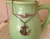Cute kitsch blue bird swallow and nautical anchor necklace