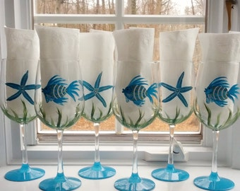 Blue Fish and starfish party hand painted wine glasses.