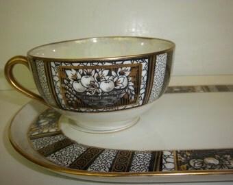 Vintage Noritake Teacup with Snack Plate black & gold on cream with basket of fruit design