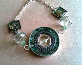 Steampunk watch parts calendar and gears charm bracelet