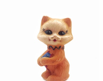 Cute  vintage rubber toy cat with friend fish. Use her for assemblage, mixed media or to keep company.