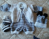 Hand knitted baby boys 1st size outfit, comprising onesie, waistcoat, bootees and star bobble hat