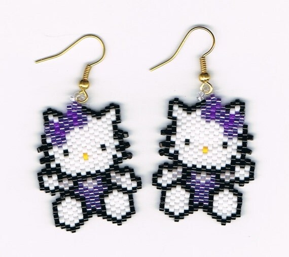 Items similar to Hand Beaded Hello Kitty earrings on Etsy