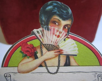 Gorgeous art deco 1920's die cut place card pretty flapper girl in holding fan with red rose decoration on her dress unused
