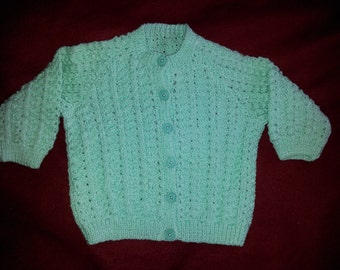 Hand knit childs cardigan in green, size 26 inch