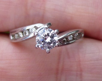 Beautiful engagement ring 55 points  total weight 35 point center round brilliant  diamonds in PLATINUM and 18KT