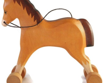 Toy Horse on weels wooden brown darkbrown colourful  Size: 13,0 x 13,0x 2,0 cm (bxhxs)  approx. 83,0 gr.