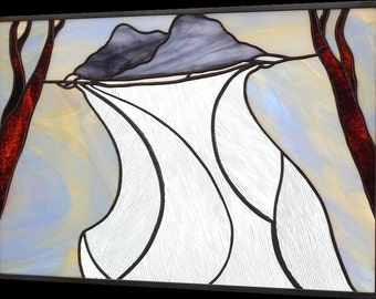 "Stained glass panel of clouds on a clothesline between trees ""Sheets Of Rain On A Silver Lining"""