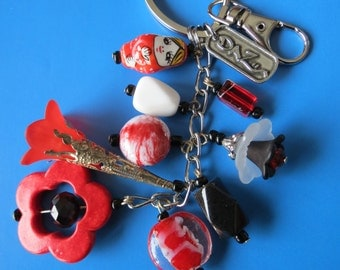 Russian Doll Beaded keychain, purse charm. Made with Red, Black and White Glass Beads, Red Turquoise Bead Frame.