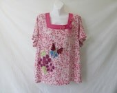 Upcycled pink cotton tunic with crochet flowers