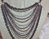 Heavy metal necklace, and earring set, mixed metals, with silver plated chain, and ear wires are ,sterling silver