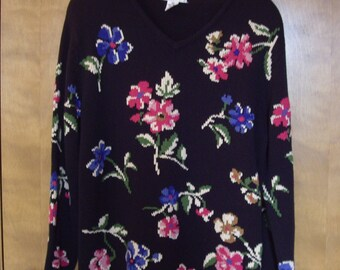 Floral cotton sweater, black background.