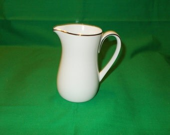 One (1), Porcelain 6 oz Creamer, from Noritake, in the Fremont 6127 Pattern.
