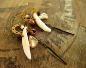 Teeth.  Rustic dangle earrings made with brass, copper, coyote teeth, vintage glass Japanese pearls, bone and wood