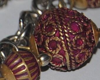 Burgundy brass bali beaded enameled bracelet charms