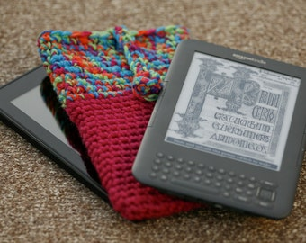 Crocheted kindle / kindle fire cover in a multicoloured and magenta yarn with crocheted button fastener