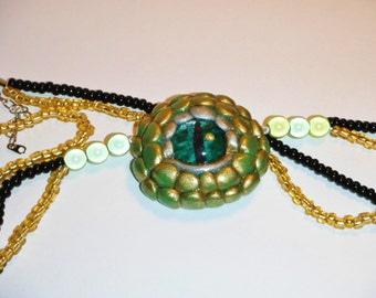 Green, Silver and Gold handmade Dragon Eye pendant and beaded necklace