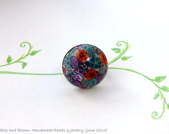 Flower Bouquet Ring: turquoise, purple, orange flowers - almost better than a bunch of flowers...