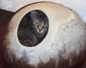 Customer order for Beth Hill. Two large  cat caves. White with brown.
