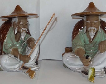 A set of Two Shiwan Ceramic Mudman Fisherman Figurines