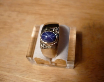 Blue Star Sapphire in sold 10kt White Gold with two diamond Chips. Size 9-  (synthetic sapphire)