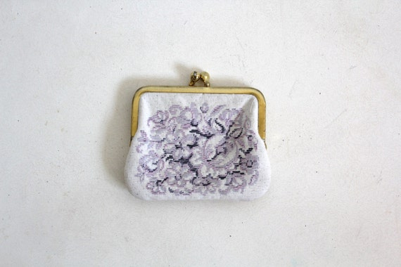 Vintage clutch purse with embroidered floral pattern and
