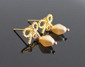 Golden bow stud earrings, creamy pearl post earrings, twisted ribbon gold earrings, simple everyday jewelry