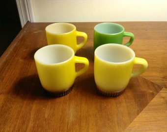 Vintage Set Of 4 Fire King Stackable Coffee Mugs - Three Yellow & One Green With Dark Bottoms