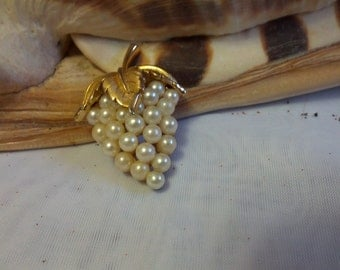 Classic Trifari grape cluster brooch set in gold tone metal and creamy faux pearls