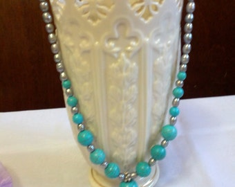 Beautiful dangle necklace with faux turquoise and silver tone plastic beads