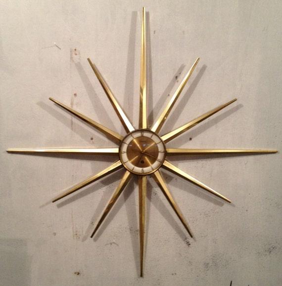 https://www.etsy.com/listing/124842159/1960s-starburst-wall-clock-atomic-mid?ref=tre-2721556973-4