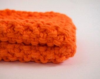 hand knit plushy cotton washcloth in bright neon orange