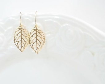Gold Earrings: Delicate skeleton leaf pendants