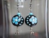 Glass Bead earrings in black with blue flower