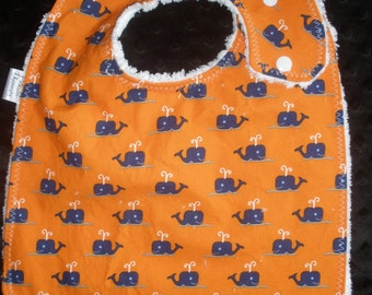 Blue Whales on Orange print Side snapping Toddler size Bib