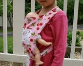 Reversible doll carrier with cherry pattern cotton fabric.