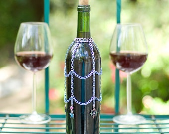 Chain wine bottle cover with shabby chic details, decorative bottle skirt, wedding table, cocktail bar.
