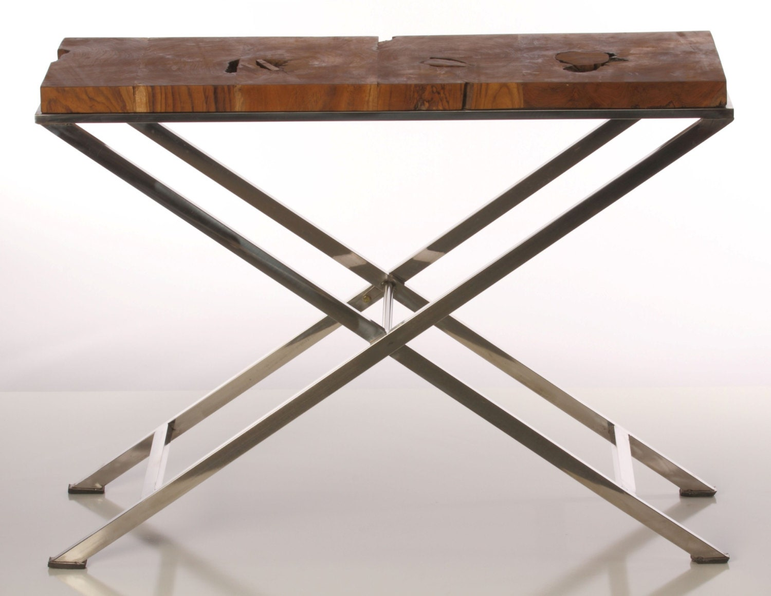 Narrow side table with chrome legs and reclaimed wood by