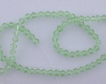 4mm green bicone glass bead strand