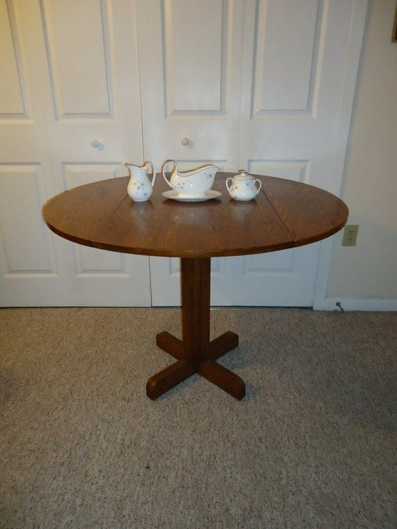 reserved do not buy round drop leaf oak dining table vintage kitchen