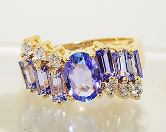 1.69ctw Oval and Baguette Cut Tanzanite & Diamond 14kt Yellow Gold Ring Size 5.5