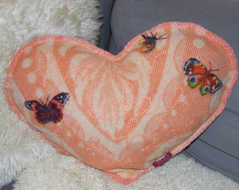 heart shaped blanket cushion: 'home is where the heart is'