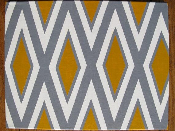 Pintura geométrica mostaza, gris y blanca