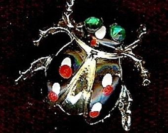 Vintage enameled beetle brooch