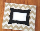 Chevron lightly distressed frame in 4x6.  Chevron is in Mystique white and Taupe.  Frame has black wavey inner trim.