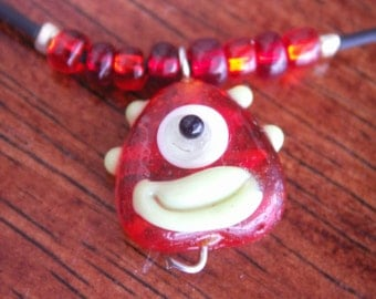 Red monster face necklace.