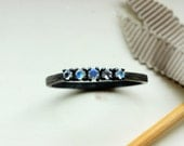 For H 2mm Round Cut Moonstone Infinity Band in Sterling Size 6.75